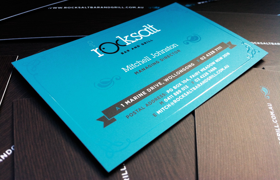 Business cards, showing the spot-UV treatment on the border