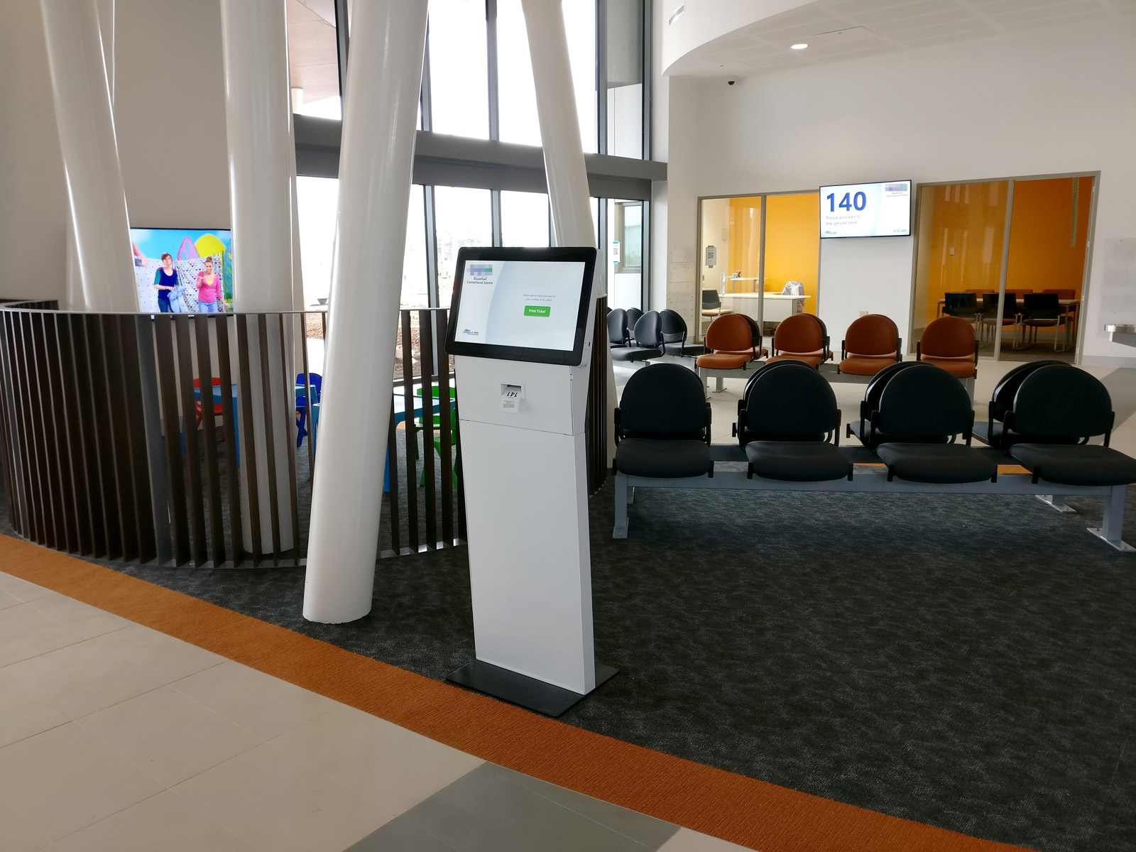 The visitor kiosk was deliberately left unbranded to better blend into the décor. Visitors collect their ticket and are directed to the waiting area. Photo courtesy Pro AV Solutions